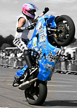 Jessica Maine performing a wheelie for the crowd