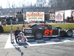 Springer, his car and his trophy, enjoying victory lane