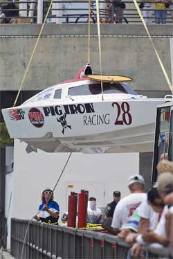 Worthy Racing Team boat on the hook as its set into the water at Long Beach, photo courtesy of Rawin Lekhakui