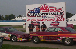 Father and son share victory lane with Super Stock Camaro and 1966 Chevy II Super Stock car in the U.S. Nationals at Indy