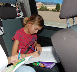 11-year-old racer stays on top of her honor roll status on the road between races