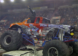 Iron Warrior Monster Truck climbs over cars in Moncton, New Brunswick