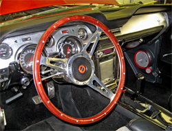 Flaming River Rack and Pinion Set up steering column matches the Dupont Hot Hues hot apple red on the Mustang exterior