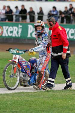 Jason Crump helped off the track at Sweden, photo by Mike Patrick