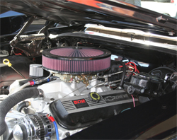 K&N air filter helps keep the engine clean on 1972 Oldsmobile Cutless in the DUB Booth at the SEMA Show in Las Vegas, Nevada