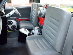 Graphic leather seats and a right-hand drive Classic Inc. steering wheel are part of the Chevy C10s interior