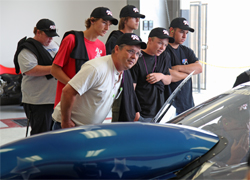 Five Ramona High School Automotive Students and Parent Tony Greenwell at K&N headquarters in Riverside, California