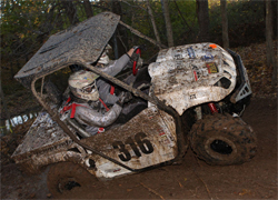 Team Faith noticed the additional horsepower and performance on its Rhino 700 as they raced through deep mud on a flat tire during the race with its K&N air intake kit