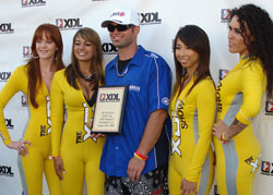 Bill Dixon accepts first place plaque for Individual Freestyle at Toyota Speedway in Irwindale, California