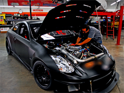 K&N employees put the final touches on the K&N Infiniti G35 before it gets wrapped for SEMA 2009