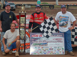 Brasstown, North Carolina Native Ray Cook celebrates big payday with his crew after winning the 100 lap Hillbilly Hundred, photo by Todd Turner