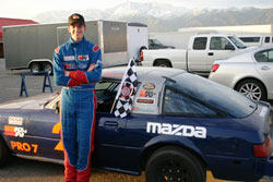 Pearlman displays his first checkered flag.