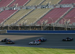 Pearlman working his way through the combined Pro-7/Miata field going into turn one on the NASCAR oval.