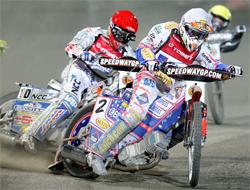 Australian Jason Crump, Sweden's Freddie Lindgren and Sweden's Andreas Jonsson battle it out at Marketa Stadium in Poland