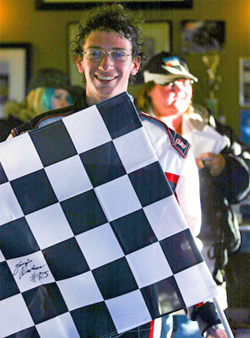Checkered flag victory for Tri-C Karters teen racer Jacob Pearlman, photo by Sean Buur of go racing magazine