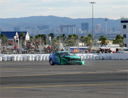 Track temperatures reached 145 degrees under the hot desert sun when Vaughn Gittin Jr., hit the wall in his 2010 Ford Mustang, photo by John Choi, provided by Falken Tires