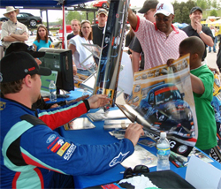 Vaughn Gittin Jr. signed autographs at Barber Motorsports Park in Alabama to celebrate 45th Anniversary of the Mustang