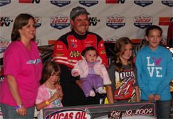 Ray Cook and his family in victory lane after he took first place in the Dixie Shootout at Dixie Speedway, Courtesy of Rick Schwallie Photos
