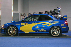 Primax Wheels Subaru sported its XXR 18x8.5 gold wheels in the Las Vegas Convention Center