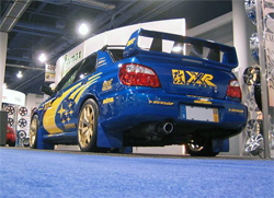 The 2005 Subaru has a Custom CF spoiler and a AIT RACING CF hood