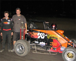 Cody and Kirk Swanson with their GOODWINE glass, K&N Filters, Lucas Oil Ford Focus Midget