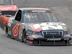 Travis Kvapil fights his way to the front