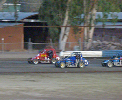Cousins battle it out in the Cotton Classic Midget race on the Kings Speedway track in Hanford, California