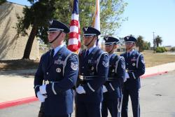 March Air Force Base Color Guard carrying the American flag and State flag of California