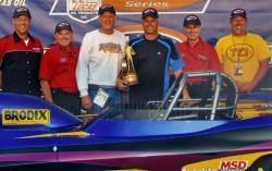 Larry and Brian (center) following Brian's win in Super Gas in 2009