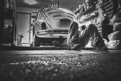 Mechanic beneath vehicle