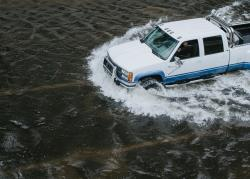 Truck driving through water