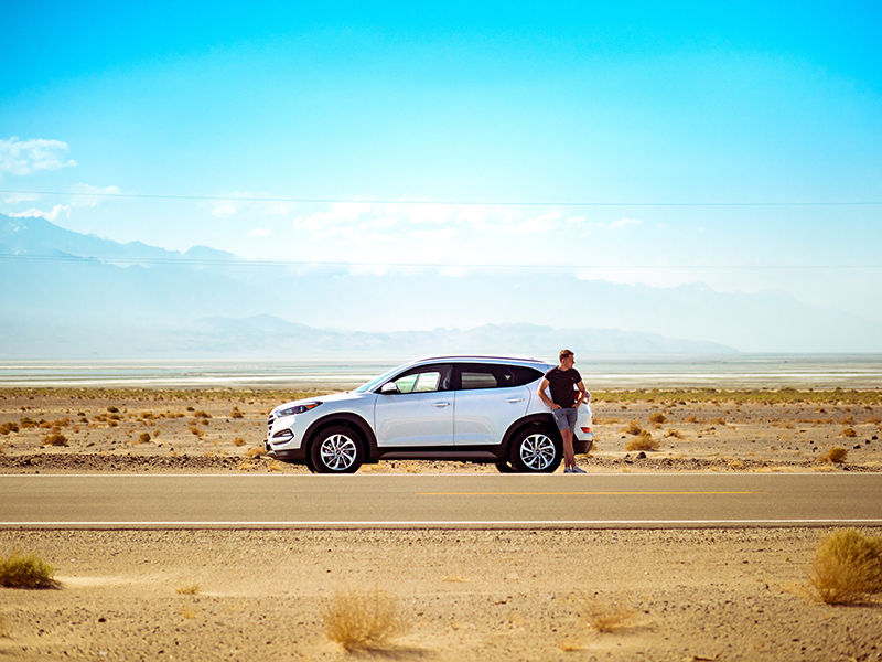 Man with SUV in the desert