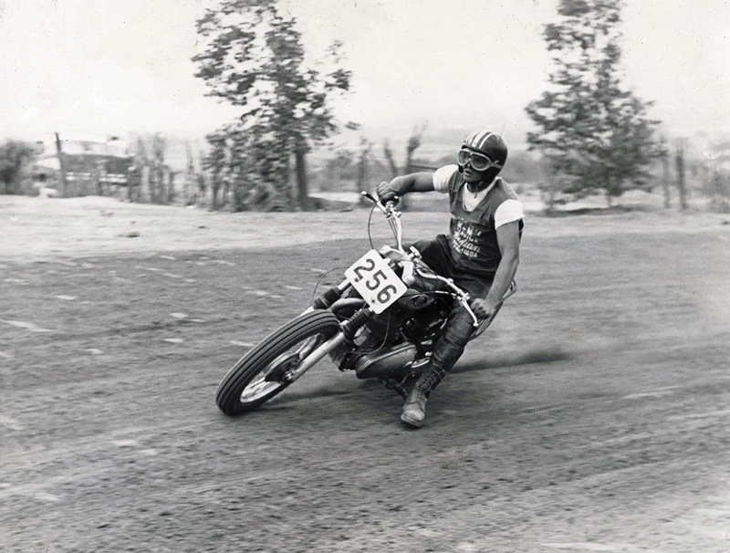 Man on motorcycle (Norm McDonald) racing at Lake Perris in 1959